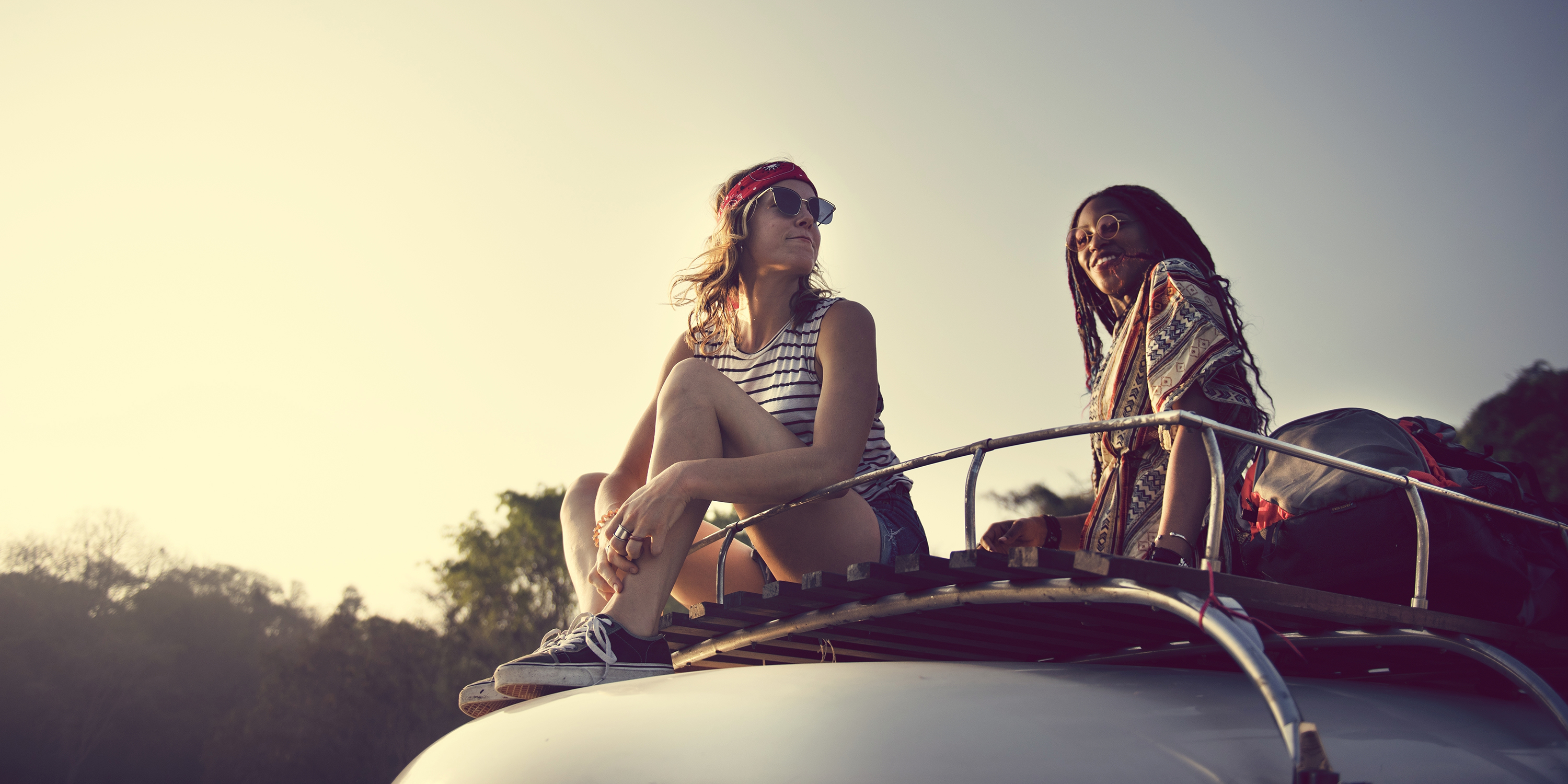 04d543115913 girls on van roof at coachella, picture